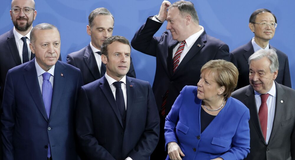 German Chancellor Angela Merkel, front second left, waits for the arrival of leaders prior to a group photo at a conference on Libya at the chancellery in Berlin, Germany, Sunday, Jan. 19, 2020.