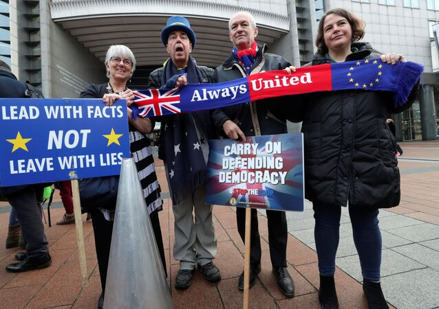 Westminster protester and anti-Brexit activist Steve Bray and members of the European Parliament take part in a protest outside the EU Parliament in Brussels, Belgium January 23, 2020