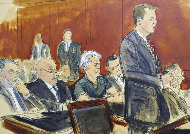 In this courtroom artist's sketch, defendant Jeffrey Epstein, center, listens as Assistant U.S. Attorney Alex Rossmiller, right, addresses the court during Epstein's arraignment, Monday, July 8, 2019 in New York