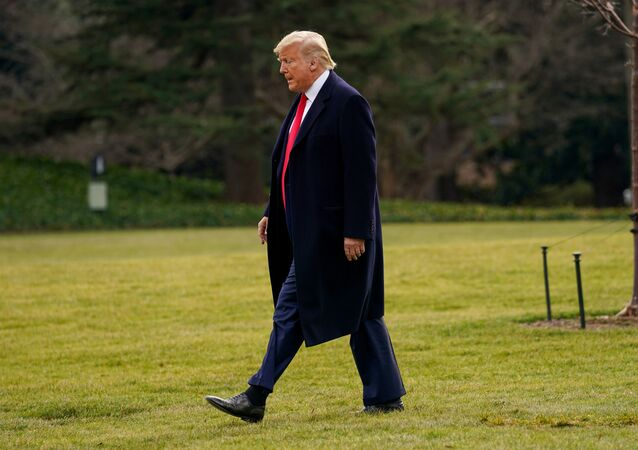 U.S. President Donald Trump walks on the South Lawn as he departs for travel to Florida the White House in Washington, January 23, 2020