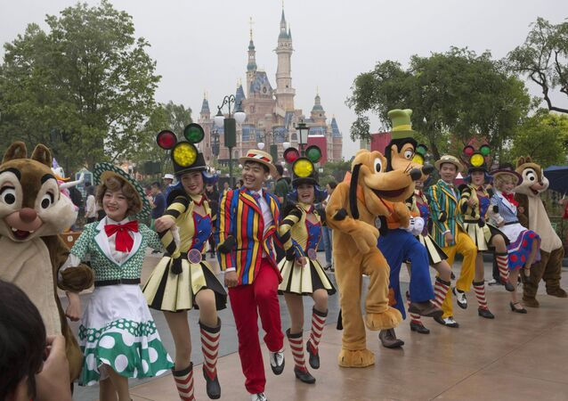 Performers take part in a parade at the Disney Resort in Shanghai, China, Wednesday, June 15, 2016 on the eve of its grand opening