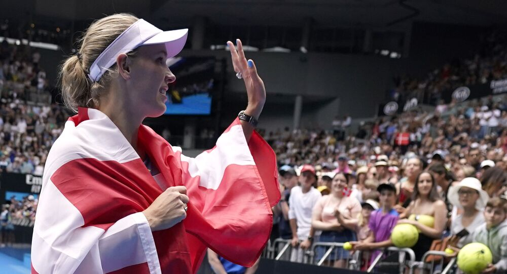 Tennis - Australian Open - Third Round - Melbourne Park, Melbourne, Australia - January 24, 2020 - Denmark's Caroline Wozniacki waves to spectators as she heads into retirement after losing the match against Tunisia's Ons Jabeur