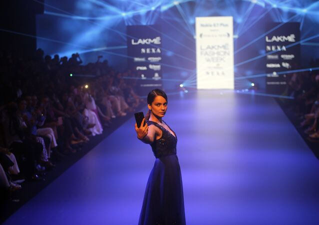 Bollywood actress Kangana Ranaut walks the ramp displaying a creation by Pankaj and Nidhi during Lakme Fashion Week in Mumbai, India, Saturday, Aug. 25, 2018
