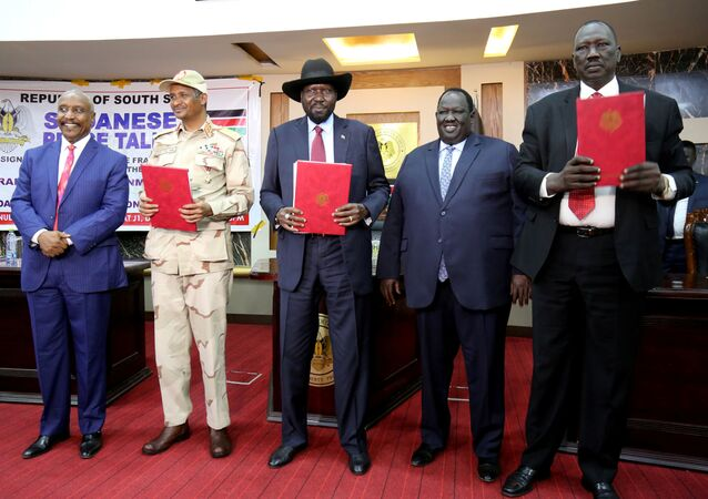 After signing Sudan's initial political and security deal with rebel group at the State House in Juba