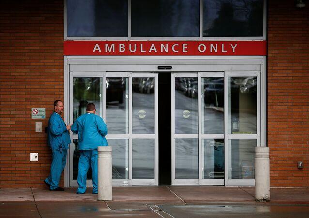 Employees next to the ambulance entrance at Providence Regional Medical Center in Everett, Washington