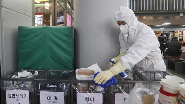 FILE - In this Jan. 24, 2020, file photo an employee works to prevent a new coronavirus at Suseo Station in Seoul, South Korea.  - Sputnik International