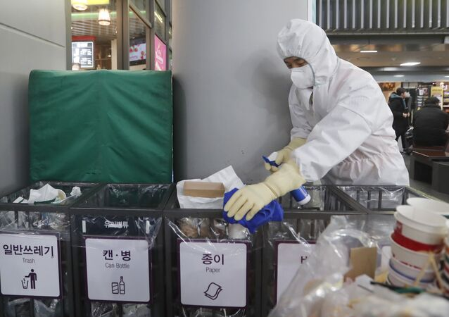 FILE - In this Jan. 24, 2020, file photo an employee works to prevent a new coronavirus at Suseo Station in Seoul, South Korea.