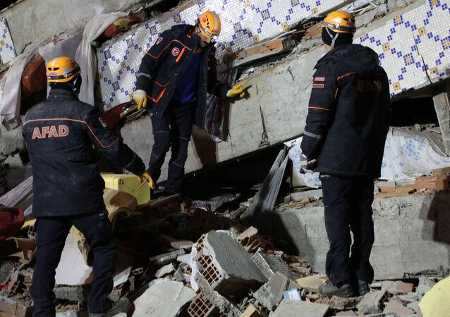 Emergency teams working at the site of the earthquake in Turkey's Elazig