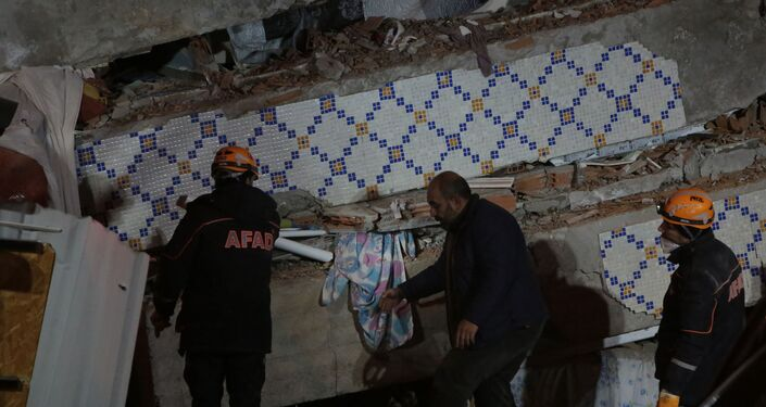 Turkish rescue teams dig through earthquake rubble