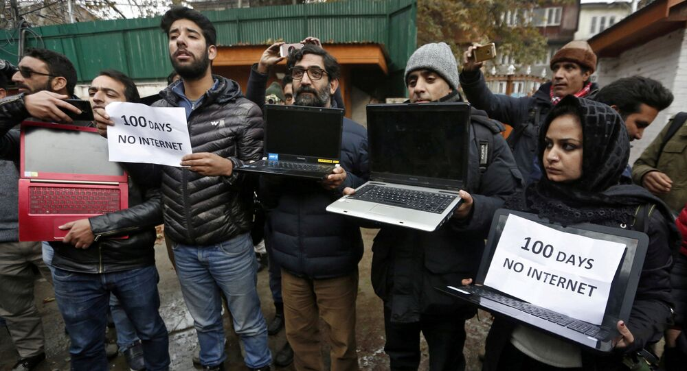 Kashmiri Journalists With Laptops and Placards