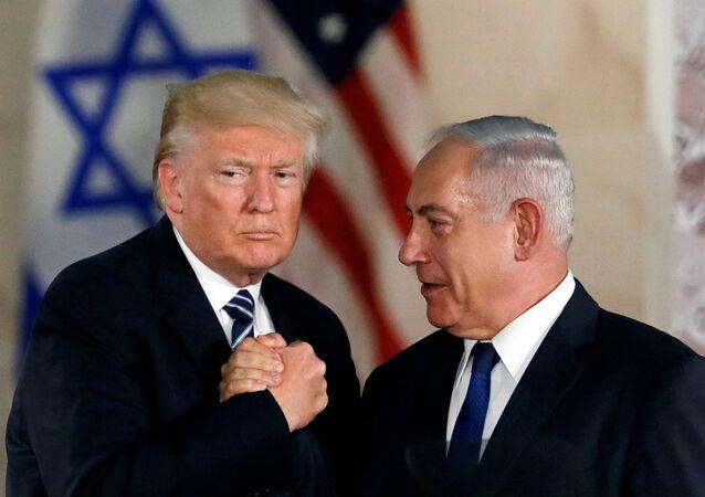 U.S. President Donald Trump and Israeli Prime Minister Benjamin Netanyahu shake hands