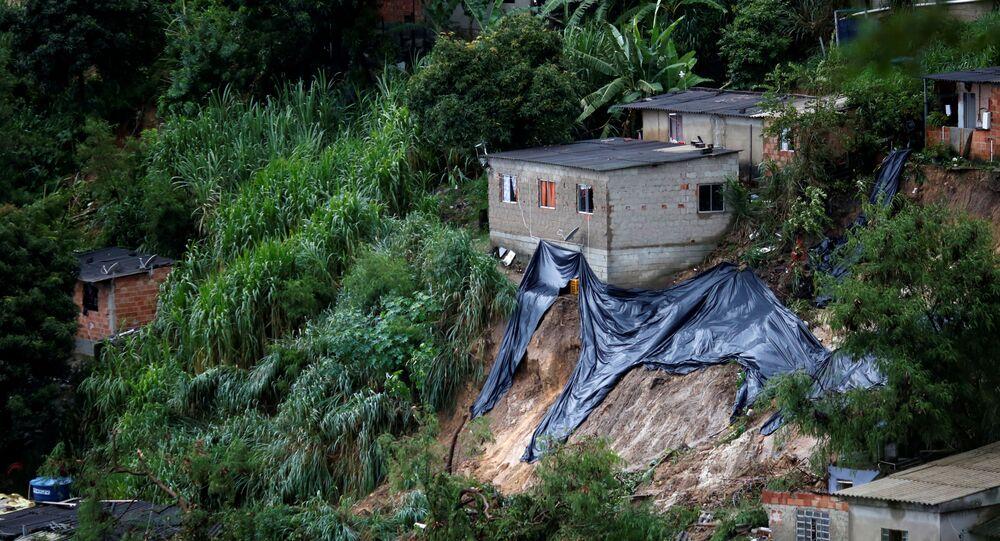 Rescue workers at Vila Ideal neighborhood in Belo Horizonte, Minas Gerais state, Brazil