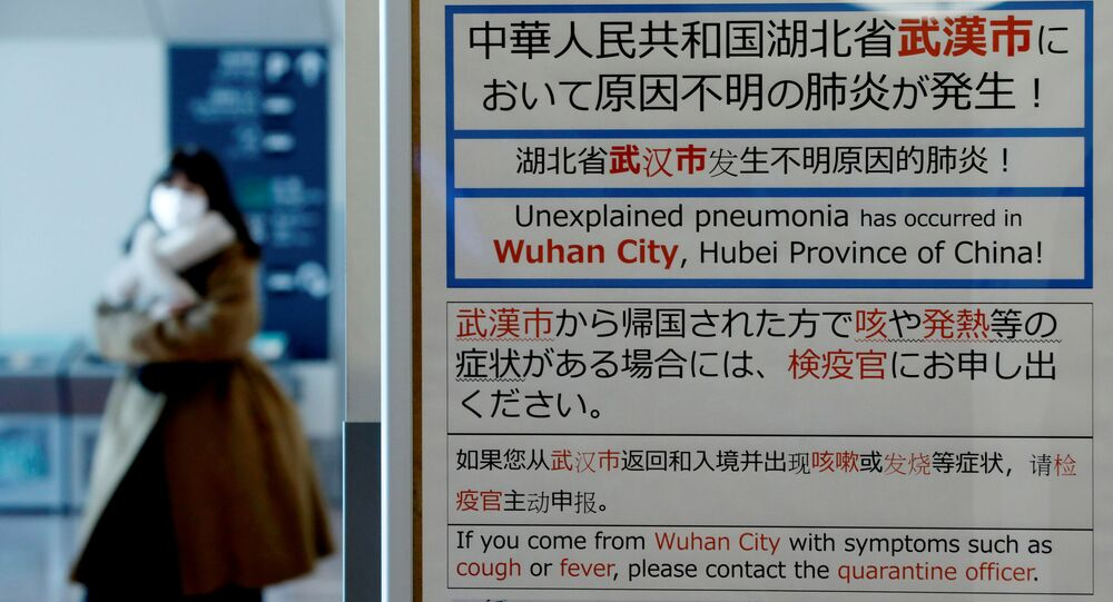 Woman Wearing a Mask Walks Past Quarantine Notice at Haneda Airport, Japan