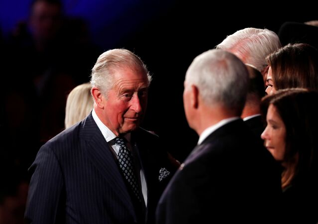 Britain's Prince Charles speaks to U.S. Vice President Mike Pence during the World Holocaust Forum
