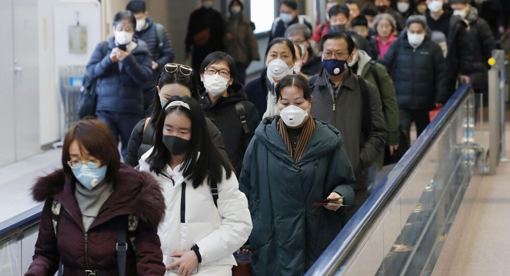 Passengers Arriving From the Chinese city of Wuhan at Narita Airport in Japan