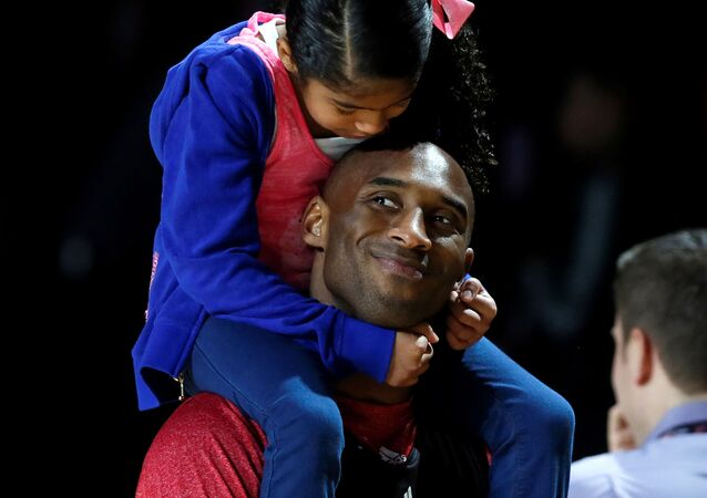 Los Angeles Lakers Kobe Bryant holds his daughter Natalia during practice for the NBA All-Star basketball game in Houston, Texas, February 16, 2013.