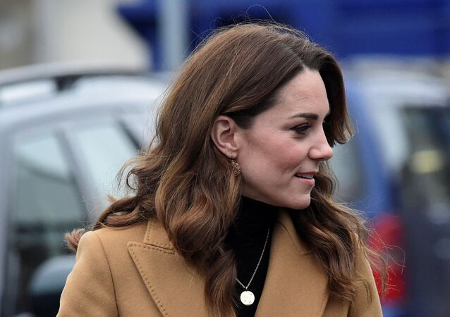 Britain's Catherine, Duchess of Cambridge arrives at Ely & Caerau Children's Centre in Cardiff
