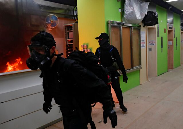Anti-government protesters set alight the lobby of a newly built residential building that authorities planned to use as a quarantine facility, as public fears about the coronavirus outbreak intensify in Hong Kong, China January 26, 2020