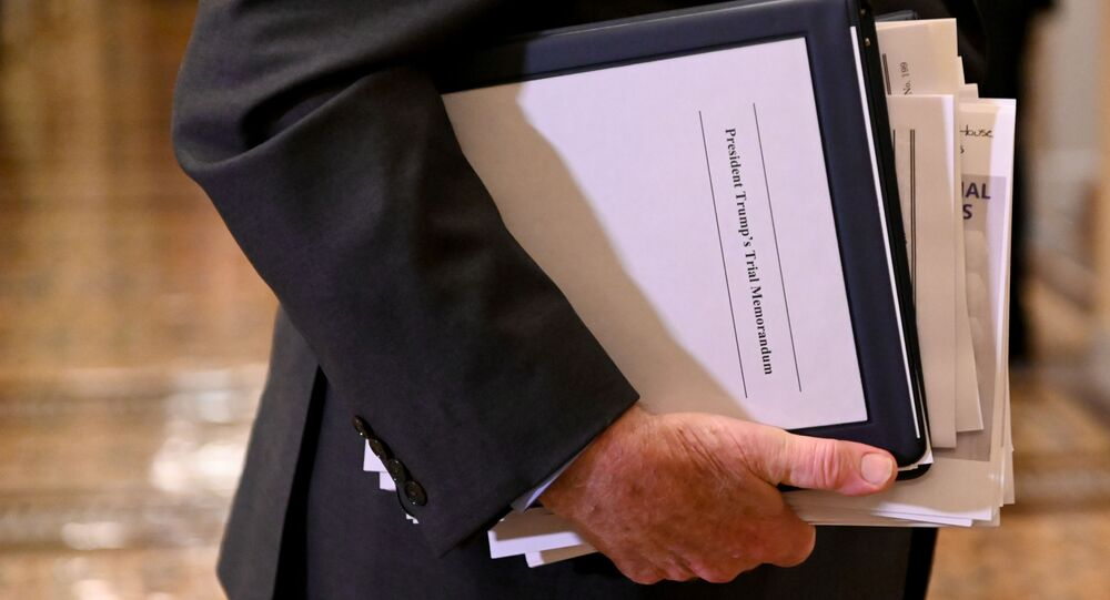 Sen. Patrick Leahy Carries Paperwork as He Exits the Senate Chamber