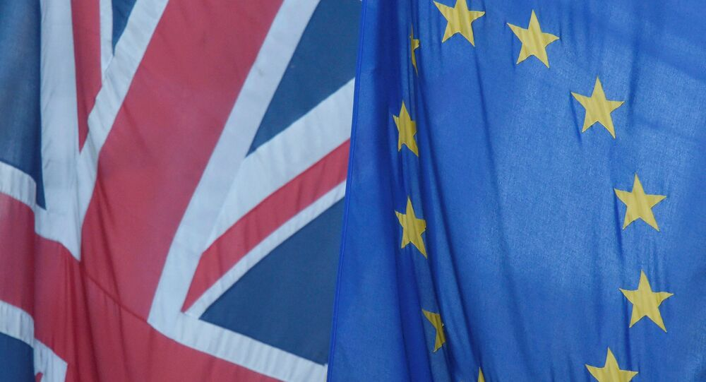 A Union flag flies next to the flag of the European Union in Westminster