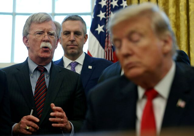 U.S. President Donald Trump listens as his national security adviser John Bolton speaks