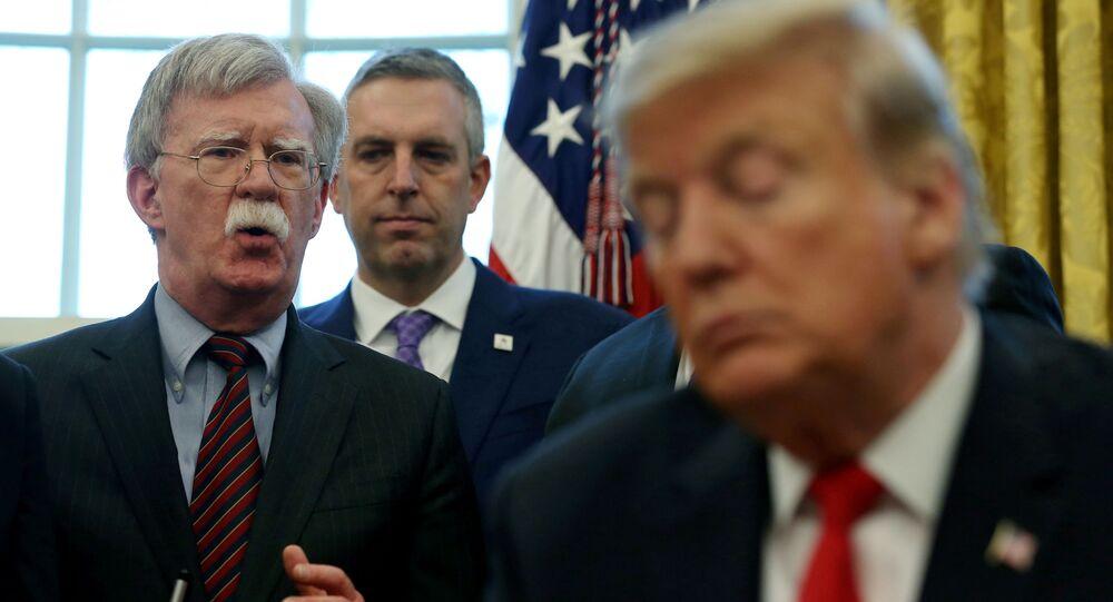 U.S. President Donald Trump listens as his national security adviser John Bolton speaks