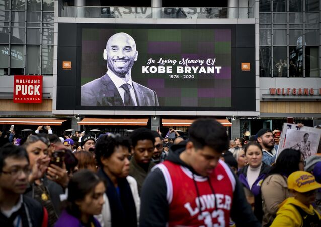 Fans mourn the loss of NBA legend Kobe Bryant outside of the Staples Center in Los Angeles