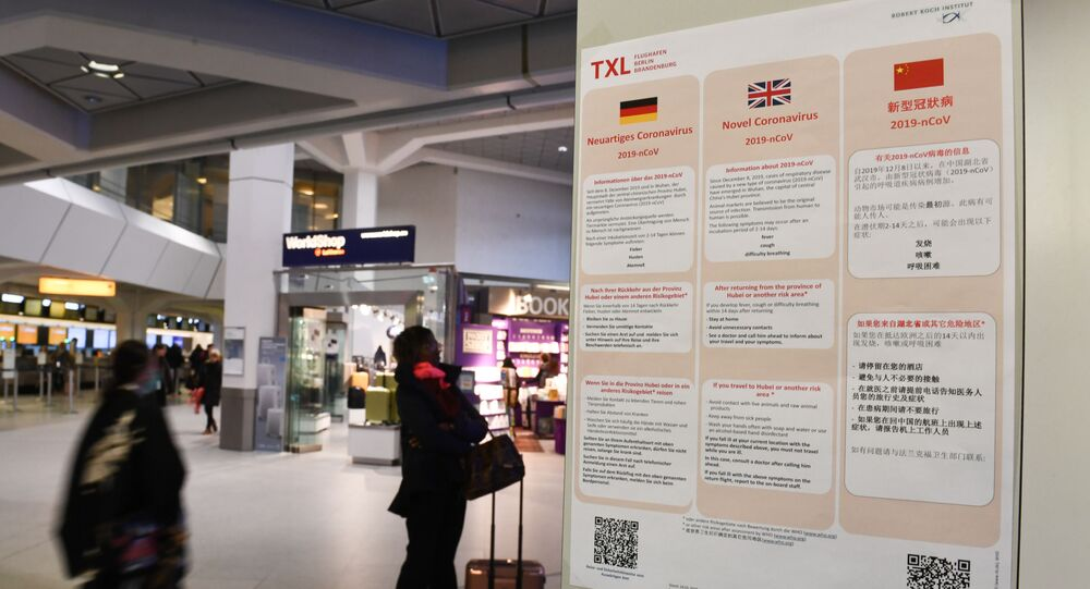 A poster with information about the coronavirus (2019-nCoV) is displayed at Tegel Airport in Berlin, Germany, January 26, 2020.