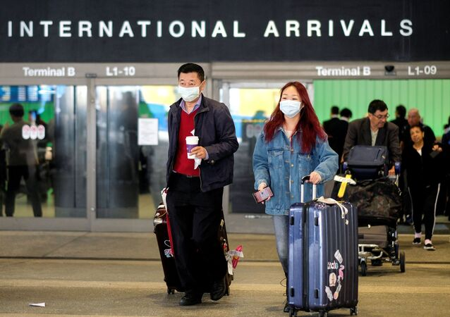 Passengers leave LAX after arriving from Shanghai, China