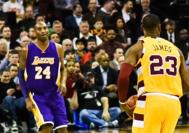 Los Angeles Lakers' Kobe Bryant, left, and Cleveland Cavaliers' LeBron James, right, are seen on the court together during the first half of an NBA basketball game, Thursday, March 10, 2016, in Los Angeles.