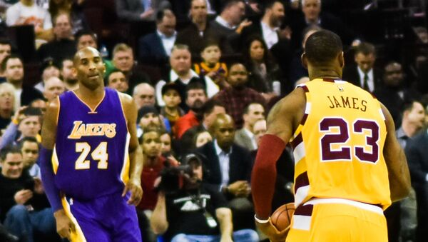 Los Angeles Lakers' Kobe Bryant, left, and Cleveland Cavaliers' LeBron James, right, are seen on the court together during the first half of an NBA basketball game, Thursday, March 10, 2016, in Los Angeles. - Sputnik International