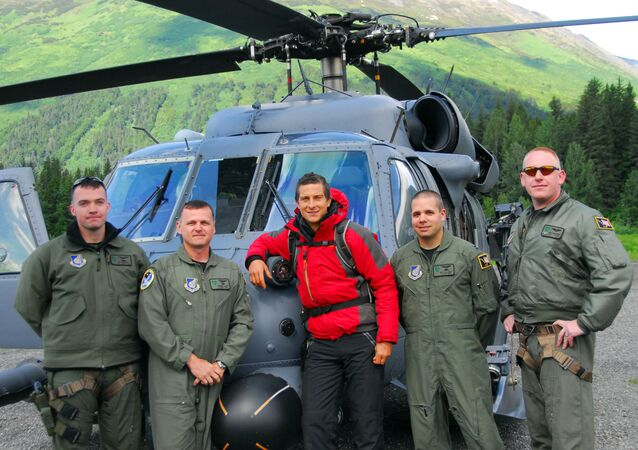 Bear Grylls in front of an Alaska Air National Guard, 210th Rescue Squadron HH-60 Pave Hawk helicopter before heading out to Spencer Glacier to film Man vs. Wild (Born Survivor)