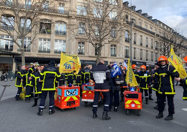 French firefighters protest in Paris
