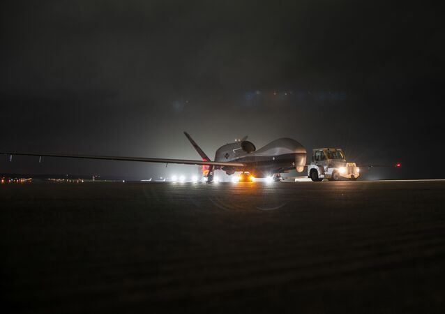 An MQ-4C Triton unmanned aircraft system (UAS) idles on a runway at Andersen Air Force Base after arriving for a deployment as part of an early operational capability (EOC) test to further develop the concept of operations and fleet learning associated with operating a high-altitude, long-endurance system in the maritime domain.