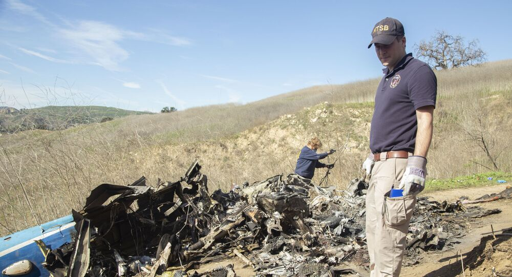 CALABASAS, California (Jan. 28, 2020) — In this photo taken Jan. 27, NTSB investigators Adam Huray and Carol Hogan examine wreckage as part of the NTSB's investigation of the crash of a Sikorsky S76B helicopter near Calabasas, California, Jan. 26. The eight passengers and pilot aboard the helicopter were fatally injured and the helicopter was destroyed. (NTSB photo by James Anderson)