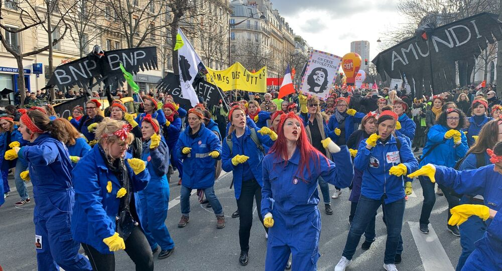 Feminist activists attend a demonstration against French government's pensions reform plans in Paris as part of another day of nationwide strikes and protests in France, January 29, 2020