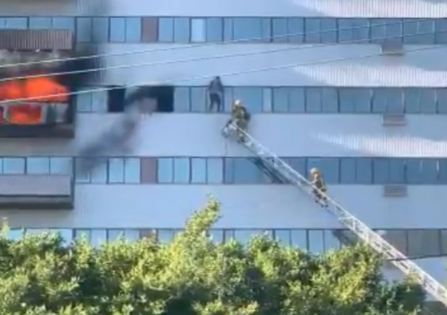 Dramatic Footage Captures Man Dangling From Burning Los Angeles High-Rise