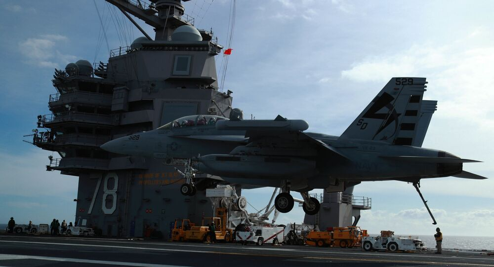 n EA-18G Growler, assigned to Air Test and Evaluation Squadron (VX) 23, prepares to land aboard USS Gerald R. Ford's (CVN 78) flight deck. Ford is currently conducting Aircraft Compatibility Testing to further test its Electromagnetic Aircraft Launch Systems (EMALS) and Advanced Arresting Gear (AAG)