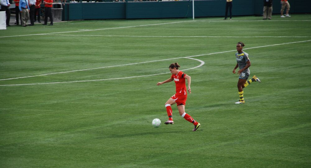 Christine Sinclair dribbles up the field.