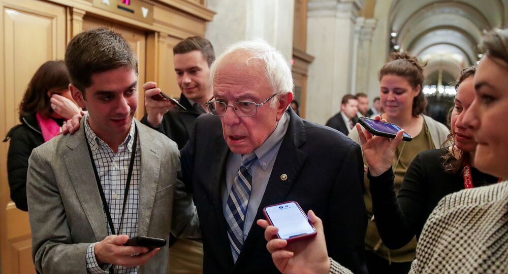 Democratic U.S. presidential candidate Senator Bernie Sanders (I-VT) is pursued by reporters after attending the Senate impeachment trial of U.S. President Donald Trump at the U.S. Capitol in Washington, U.S., January 28, 2020.