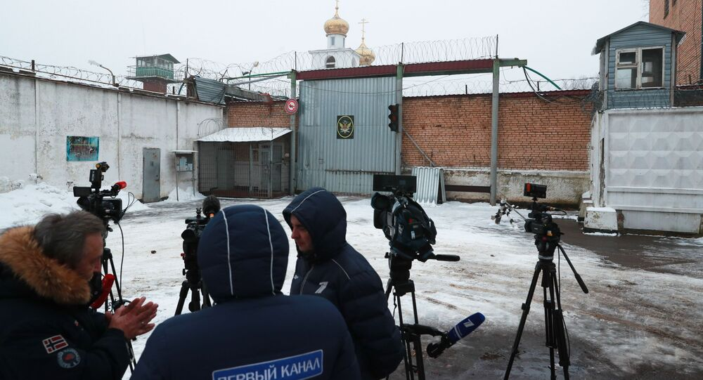 Journalists wait near Prison Colony 1 of the Moscow Region Branch of the Russian Federal Penitentiary Service where Israeli citizen Naama Issachar, sentenced in Russia for 7.5 years in prison for smuggling drugs, is serving her sentence, in the Novoe Grishino village, Russia
