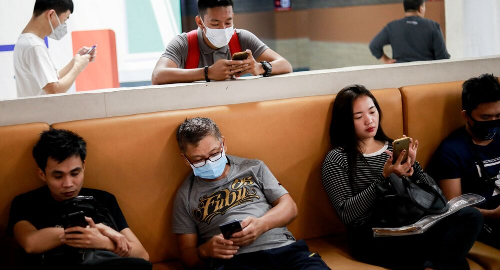 People wear masks at a transportation hub in Paranaque, Metro Manila, Philippines, January 30, 2020