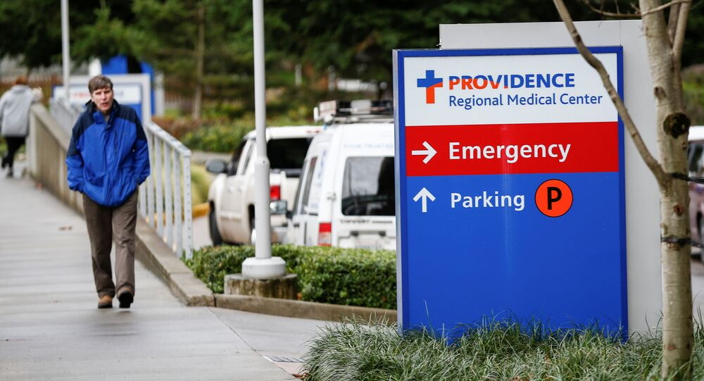 A man walks by the Providence Regional Medical Center campus after a spokesman from the U.S. Centers for Disease Control and Prevention (CDC) said a traveler from China has been the first person in the United States to be diagnosed with the Wuhan coronavirus, in Everett, Washington, U.S. January 21, 2020