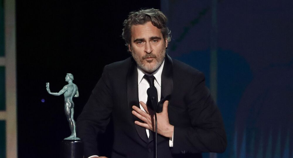 26th Screen Actors Guild Awards - Show - Los Angeles, California, U.S., January 19, 2020 - Joaquin Phoenix accepts the award for Outstanding Performance by a Male Actor in a Leading Role for The Joker.