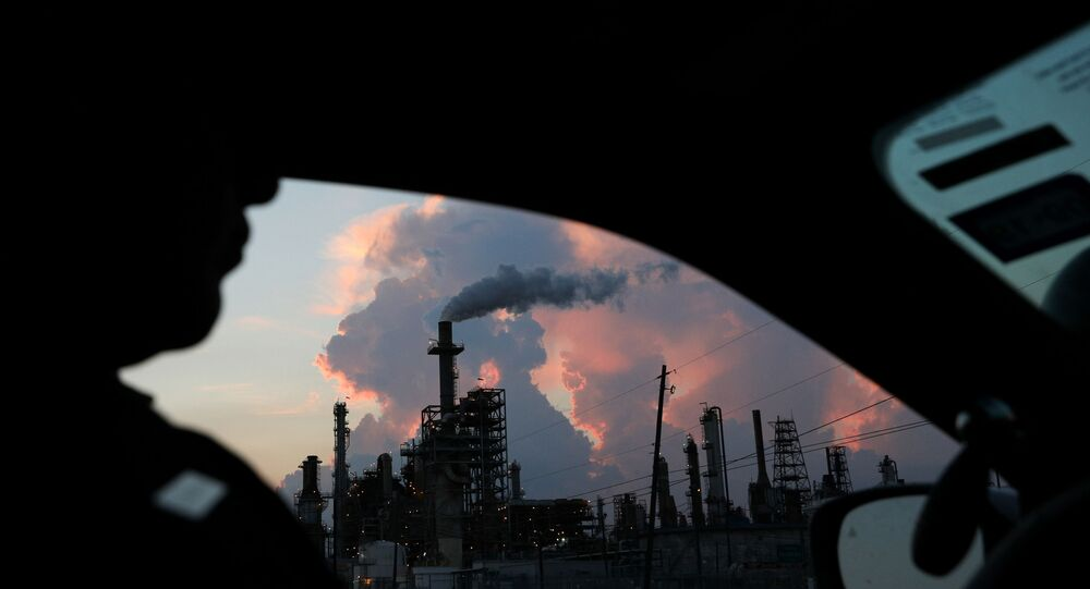 A police officer drives past a refinery in the industrial east end in Pasadena, Texas, U.S., September 18, 2018. REUTERS