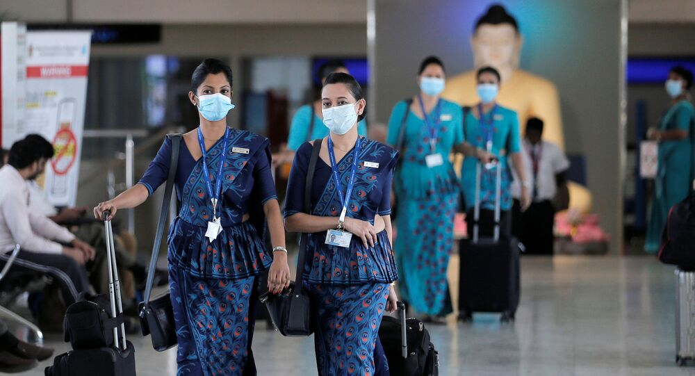Sri Lankan Airlines staff wear masks at Bandaranaike International Airport after Sri Lanka confirmed the first case of coronavirus in the country, in Katunayake, Sri Lanka January 30, 2020.