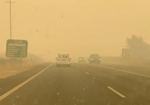 Cars drive in smog on the road to Cooma from Canberra in Bredbo, Australia