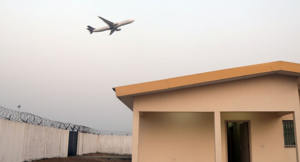 A plane takes off above the pandemic center where a suspected case of coronavirus is under observation