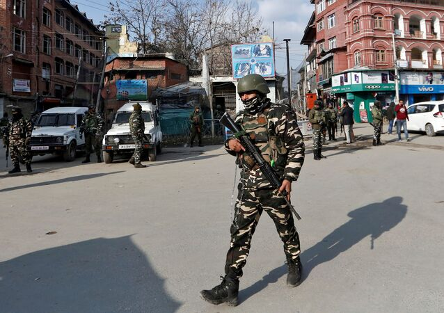 Indian security forces personnel patrol a street in Srinagar January 10, 2020.