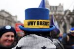 An anti-Brexit protester wearing a hat demonstrates outside the Houses of Parliament in London, Britain January 30, 2020.